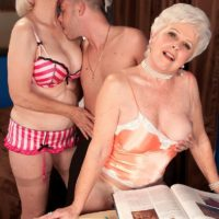 Horny grandmothers Jewel and Lola Lee giving double blowjob in tan stockings