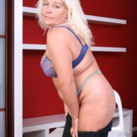 Mature blonde BBW undressing out of skirt and lingerie to pose fat ass in the nude