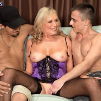 Mature blonde pornstar Bethany James jacking 2 cocks in lingerie and nylons