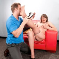 Pantyhose attired grandma Donna Davidson undressed for sex by younger man
