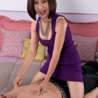 Petite Asian granny Kim Anh flashing white lace panties during foreplay