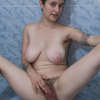 Short haired all natural amateur girl Sue displaying hairy underarms and beaver