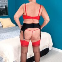 Short haired granny Joanne Price seducing younger man in nylons and garter