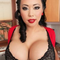 Asian MILF Tigerr Benson freeing huge boobs from bra while spreading in kitchen