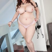 BBW solo girl Roxee Robinson freeing huge boobs from dress in panties and heels