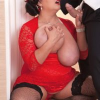 Brunette BBW Nila Mason unleashing massive tits before giving BJ in stockings