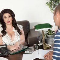 Brunette BBW pornstar Angel DeLuca having huge boobs exposed in office