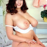 Chubby brunette MILF Kerry Marie releasing massive all natural boobs from white bra
