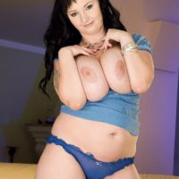 Dark haired BBW Denisa loosing huge boobs from bra before masturbating pussy
