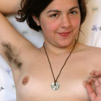 European amateur displaying hairy underarms before releasing hairy cunt from panties