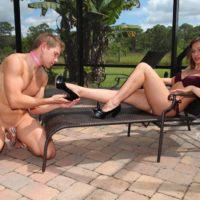 High heel and bikini clad dominant wife Callie Calypso receiving foot worship from sub