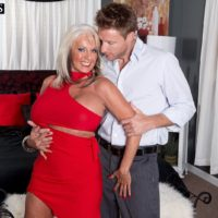 Leggy over 60 MILF Sally D'Angelo having huge boobs freed from dress in high heels