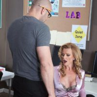 Mature blonde schoolteacher Amanda Verhooks caught giving blowjob in skirt