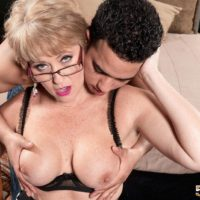 Mature woman Tracy Licks having big boobs exposed for nipple licking in glasses
