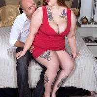 Tattooed BBW Busty Emma exposing huge boobs and ass before giving handjob