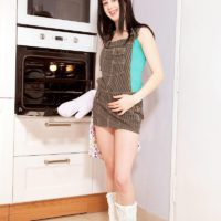 Boots wearing brunette amateur Lolly exposing tiny teen tits and phat ass in kitchen