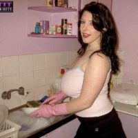 Brunette MILF Angela White modeling non nude in skirt and in bathroom and kitchen