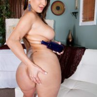 Brunette MILF Vanessa Luna flashing big butt and tattoos before baring big boobs