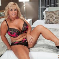 Chubby over 50 blonde MILF Zena Rey freeing big tits from bra while seducing man