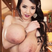 Dark haired Asian solo girl Hitomi unleashing massive tits in stockings and panties