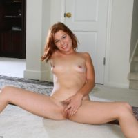 Natural redheaded amateur flaunting perky tits and neatly trimmed pussy