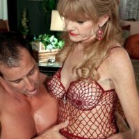 Over 50 MILF Denise Day letting big boobs loose from lingerie for nipple licking