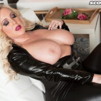 Thick blonde model Holly Wood letting huge all natural tits loose from leather outfit