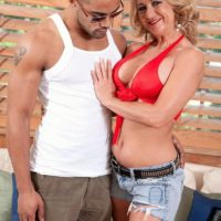 Aged blonde woman Cali Houston freeing big boobs while seducing younger man