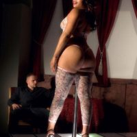 Black stripper Candi Luvv showing off big booty while sucking cock in high heels