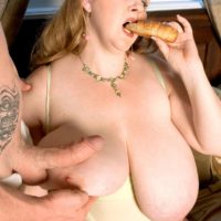 Blonde feeder Sapphire unleashing massive tits before giving handjob while eating