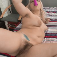 Blonde MILF Jill baring big saggy boobs in pigtails before masturbating hairy cunt