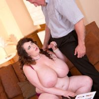 Brunette BBW Anna Beck unleashing huge tits before giving BJ and fucking on sofa