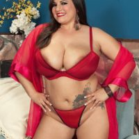 Brunette BBW Melonie Max tit smothering man with huge boobs in red lingerie