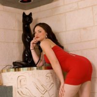 Brunette MILF Leenuh Kai revealing perfect ass and pussy underneath red dress