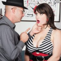 Brunette MILF May West having large boobs and hard nipples exposed by man in hat