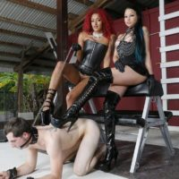 Cruel mistress Daisy Ducati and fellow Domme abuse submissive man with high heels
