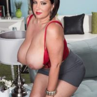 Curvy brunette MILF Paige Turner freeing massive all natural tits from brassiere