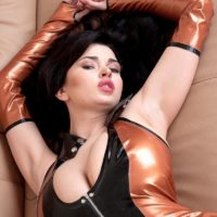 Dark haired babe Sha Rizel flashing no panty upskirt in latex dress and high heels