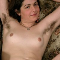 European amateur Gypsy showing off pierced nipples, furry armpits and hairy bush