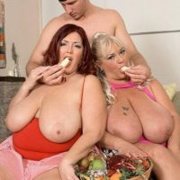 Fat women Shugar and Peaches LaRue giving long cock oral sex while eating food