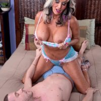 Hot over 50 MILF Sally D'Angelo flashing big tits while seducing man for sex on bed