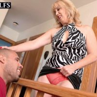 Mature blonde cougar Rebecca Williams seducing younger man for sex on bed