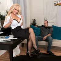 Older blonde boss lady Bella Dea unleashing large tits before giving BJ in office