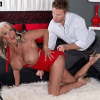 Over 50 MILF Sally D'Angelo having large tits freed from dress by younger man