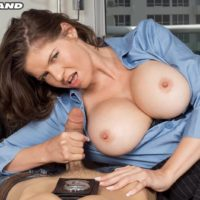 Big boobed brunette policewoman June Summers giving handjob to big cock