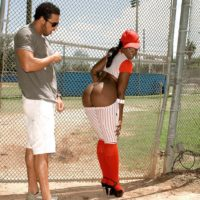 Black chick Kali Dreams letting big booty loose from baseball uniform outdoors