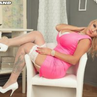 Blonde babe Dolly Fox letting huge tits free wearing white stockings and high heels