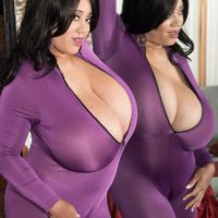 Brunette MILF Roxi Red letting massive breasts loose from purple onesie