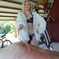 Clothed domme Isobel Raven and girlfriends cane bound man on bondage table