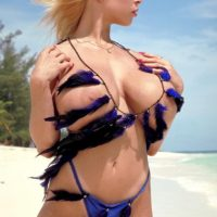 Famous blonde pornstar Tiffany Towers flaunting hooters outdoors on beach